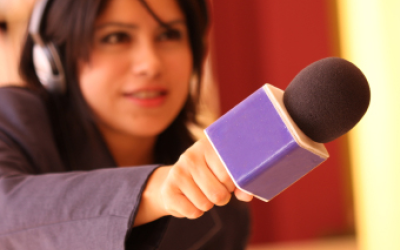 Video Interview image of woman holding microphone to interviewee